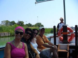 Group visiting Venice Lagoon on a bragozzo, a typical boat